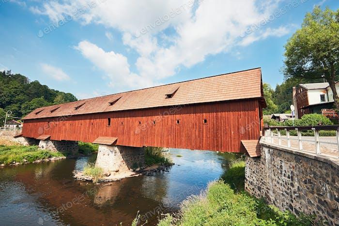 Covered wooden bridge over the river in Radosov, Czech Republic