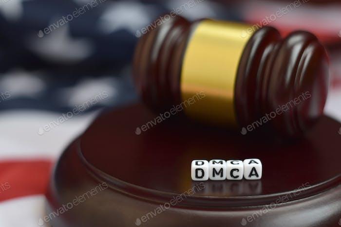 Justice mallet and DMCA acronym close up. Digital millenium copyright act
