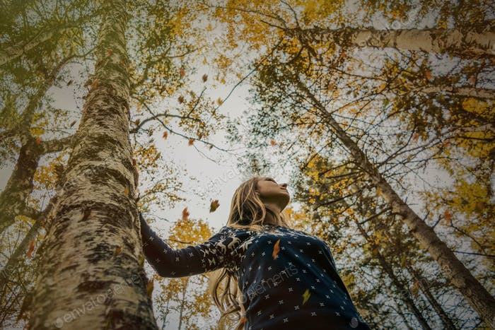 girl in the fall forest.