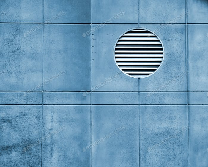 Minimalism - air vent on a concrete wall