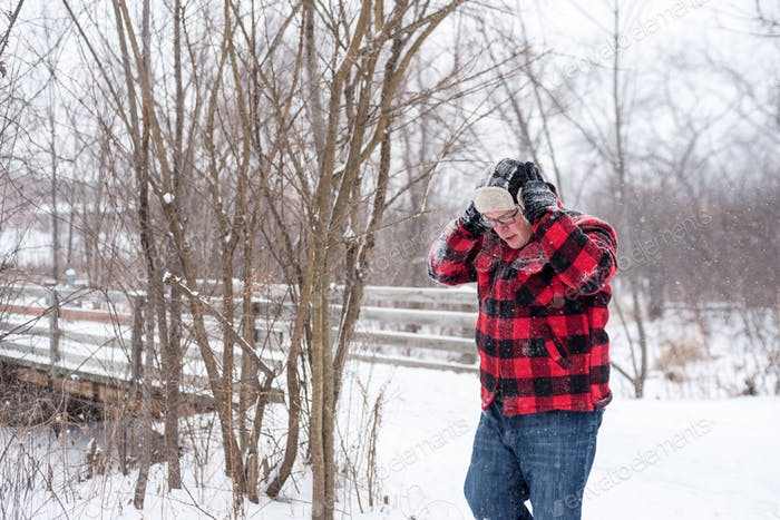 Man in red plaid walking through the woods on a snowy day - commercially cleared  💫