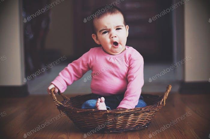 Yawning baby tired