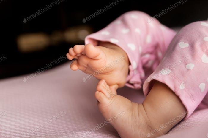 Adorable newborn baby feet, lifestyle baby legs