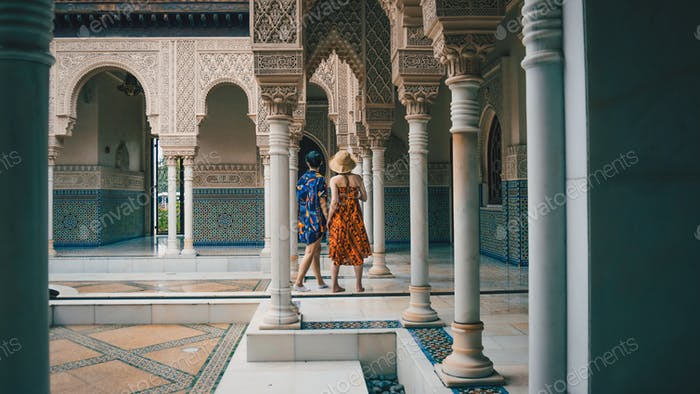 2 girls at a Moroccan style mosque.