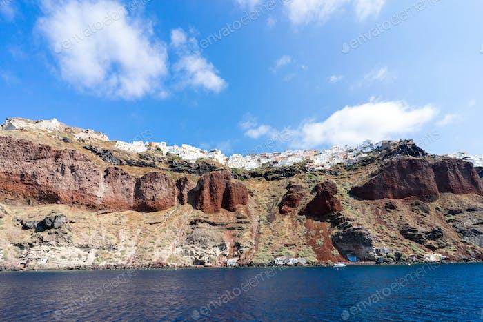 Sailing the Aegean Sea in Santorini, beautiful view of the town Oia