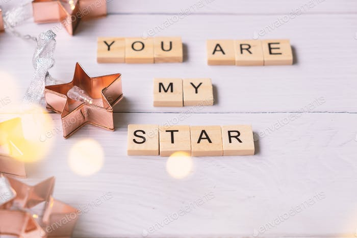 Wooden alphabet blocks say You are my star on table
