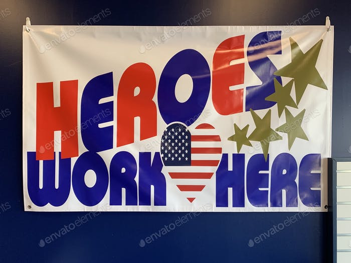 "Big banner at the post office that reads ""Heroes work here"" during Covid19 pandemic."