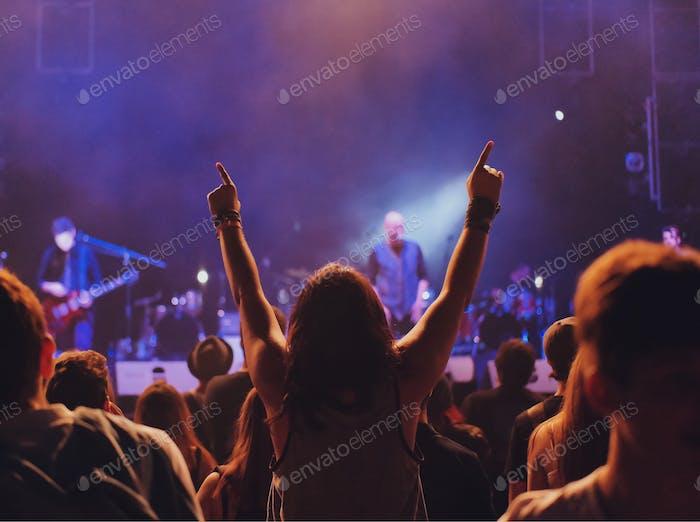 Enthusiastic fan at a rock concert