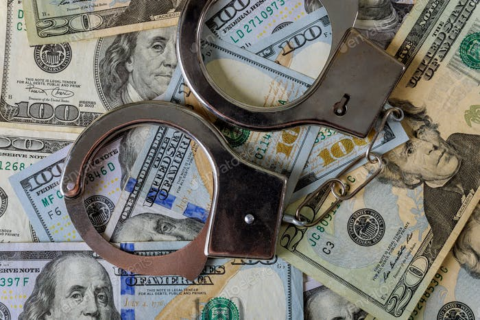 US dollar banknotes money cash corruption, dirty money financial crime and metal police handcuffs