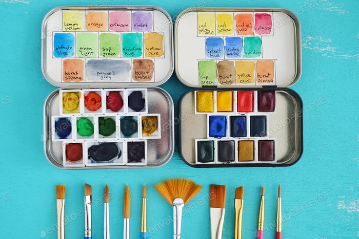 small watercolour tins and watercolour brushes