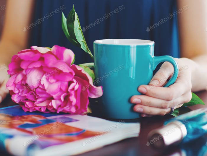 pleasant morning, the turquoise mug with tea and delicate peony