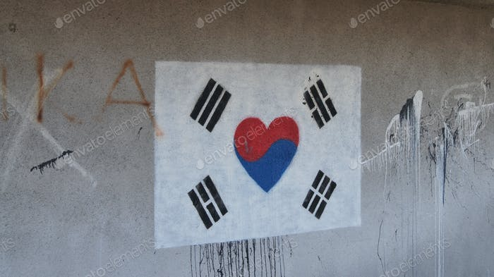 A mural of a South Korean flag with a heart shape in the middle.