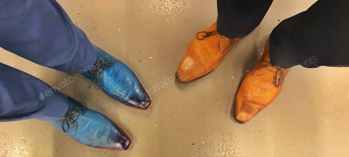 From Where I Stand Men looking down at their funky and fashionable brown and blue suede shoes