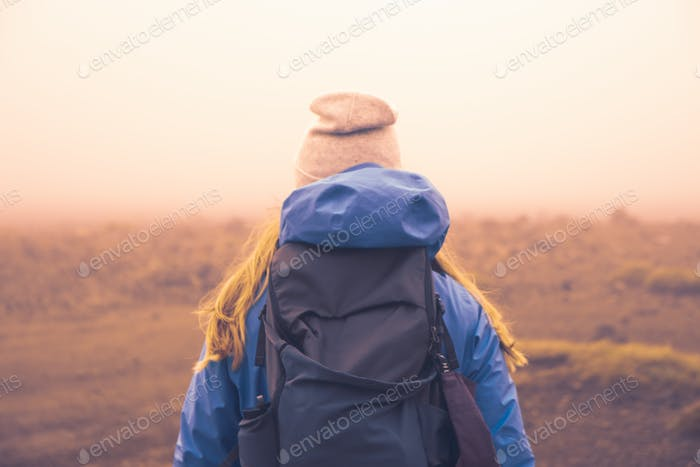 NOMINATED * Girl wearing a beanie on a cold and foggy trip through Mordor, the Tongariro Alpine Cros