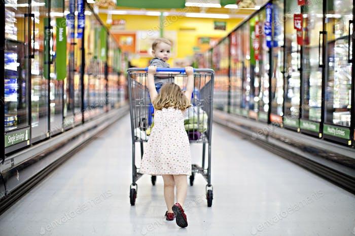 Girl grocery shopping