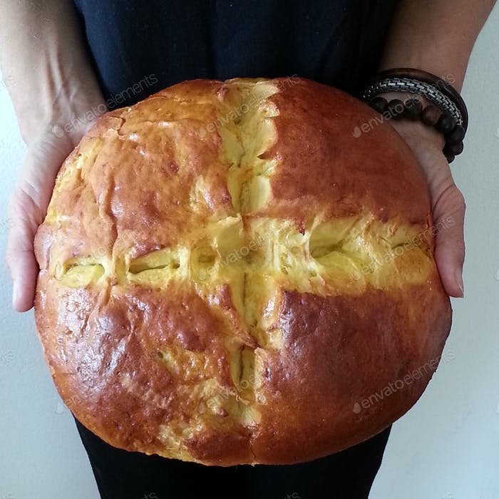 Overhead view of hands holding sweet bread,Easter tradition in Dalmatia,Croatia