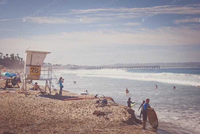 Southern California beach with people and lifeguard station