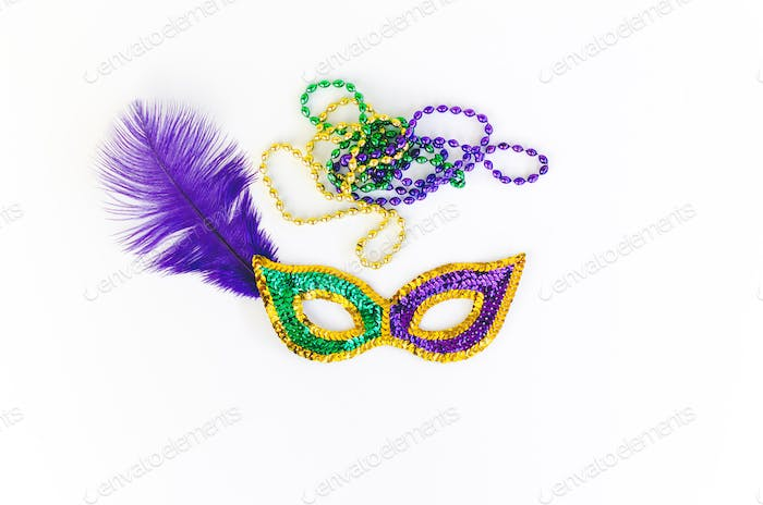 Mardi Gras masks and beads in purple gold and green