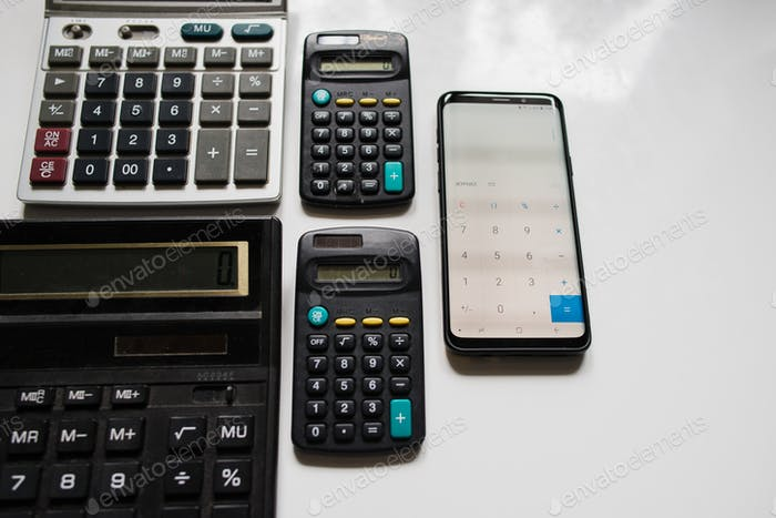 Different calculators and phone with calculator turned on