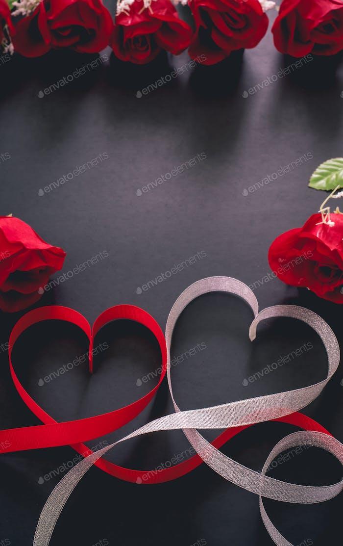 valentine's day celebration. rose and ribbon on black background