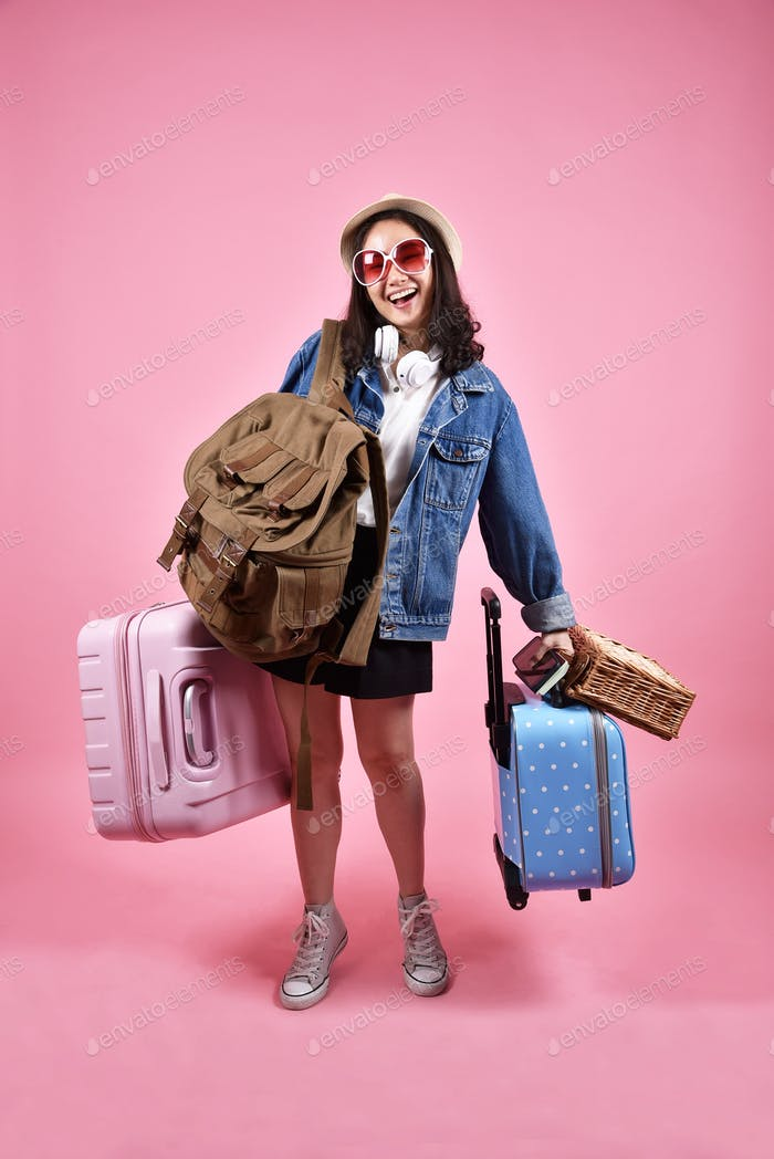 Smiling asian woman traveler carry lot of baggage
