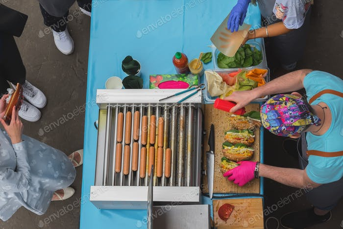 ☀ NOMINATED!!! ☀    High angle view of cooking barbecue. Man with healthy vegan street food, sausage