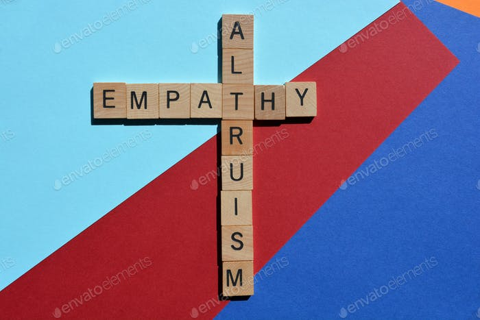 Empathy, Altruism, words in 3D wooden alphabet letters in crossword form on coloured background