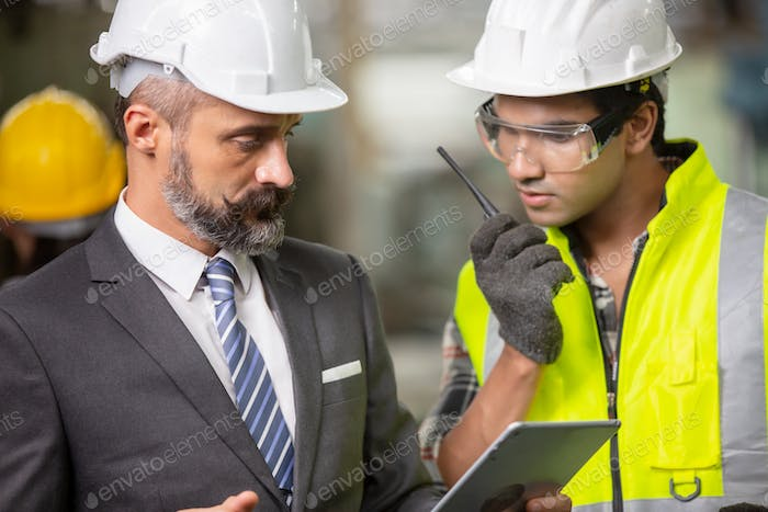 Business man and foreman at construction site