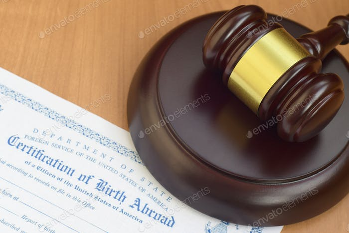 Justice mallet and United States Certificate of Birth Abroad close up