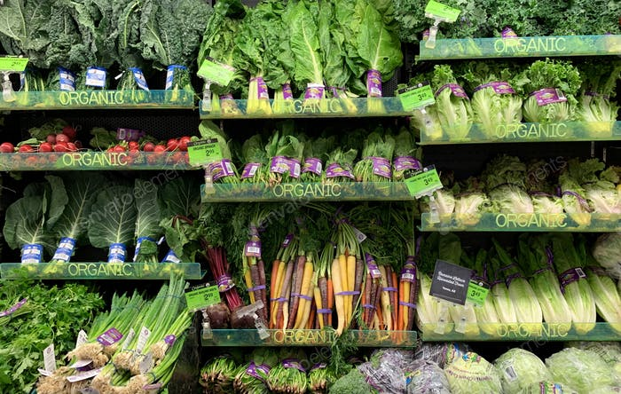 Fresh organic vegetables in the produce section of the grocery store
