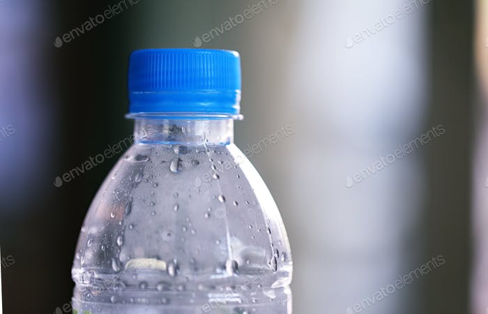 Empty plastic bottle closeup blur background