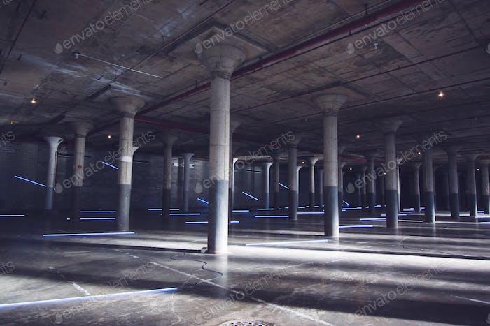 Industrial indoor architecture with neon light artwork