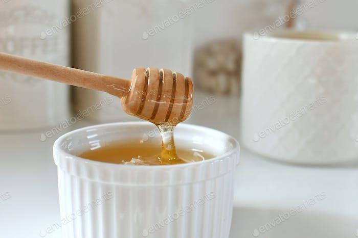 Honey dripping off a honey dipper