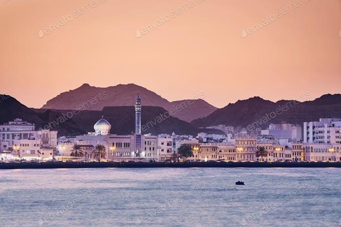 Cityscape view of Muscat city at golden sunset. The capital of Oman.