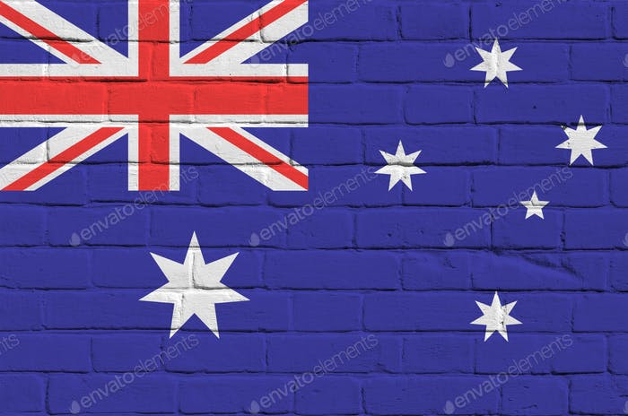Australia flag depicted in paint colors on old brick wall close up