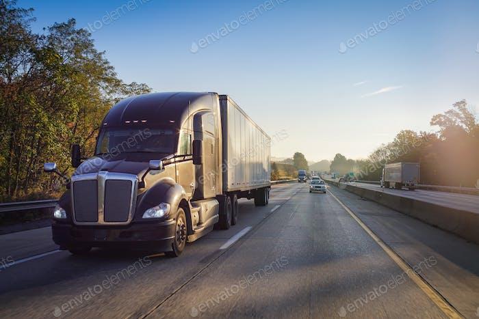 Diesel truck semi tractor trailer on the highway