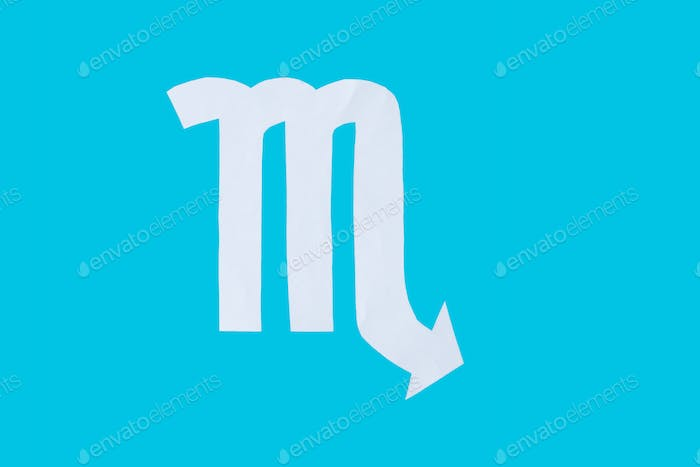 paper cut horoscope sign Scorpio isolated on a blue background