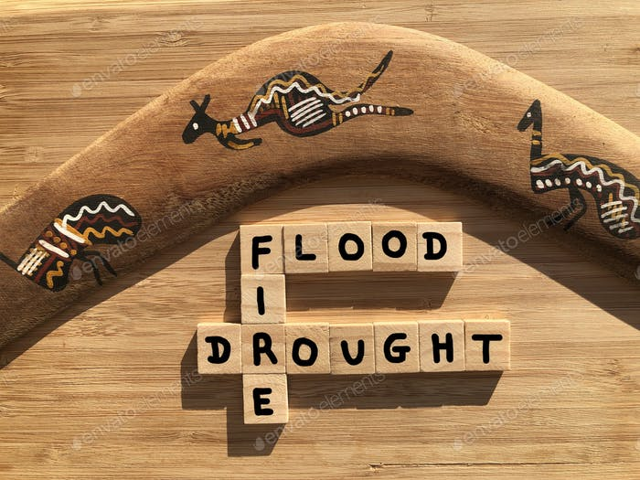 Flood, Fire, Drought in 3D wooden alphabet letters in crossword form with a n Australian boomerang