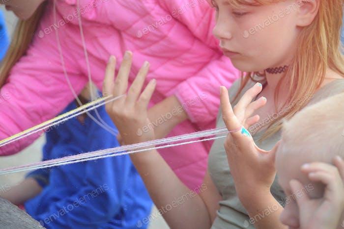 Girl braids bracelets