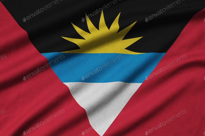 Antigua and Barbuda flag  is depicted on a sports cloth fabric with many folds