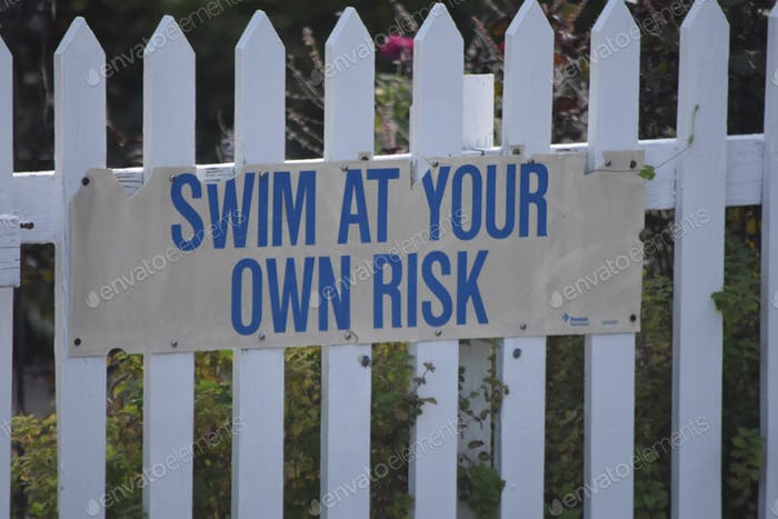 Warning sign. Swim at your own risk
