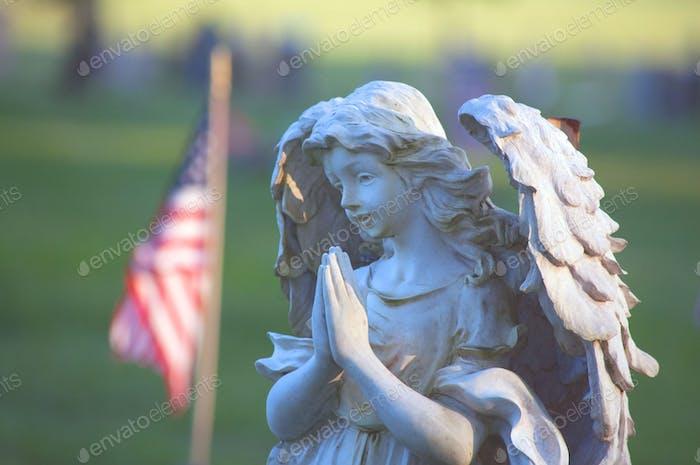 NOMINATED - An Angel Statue Memorial Praying & U.S.A. Flag at a Graveyard