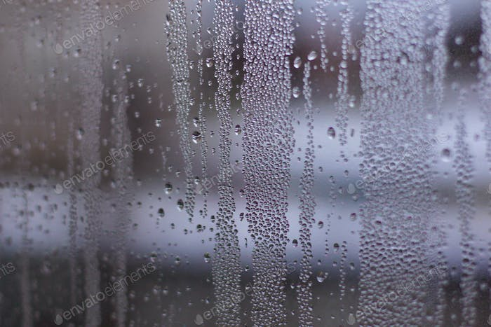 Water drops on the window glass. Condensation. Rain. Abstract background texture.