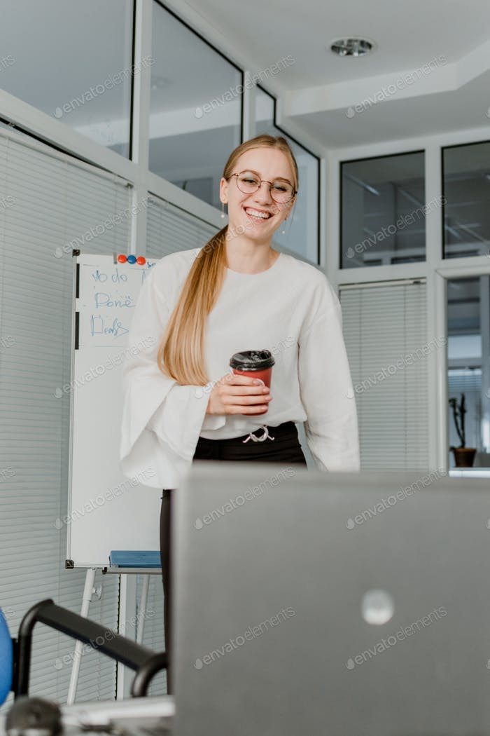 Business woman talking to her colleagues in video conference.