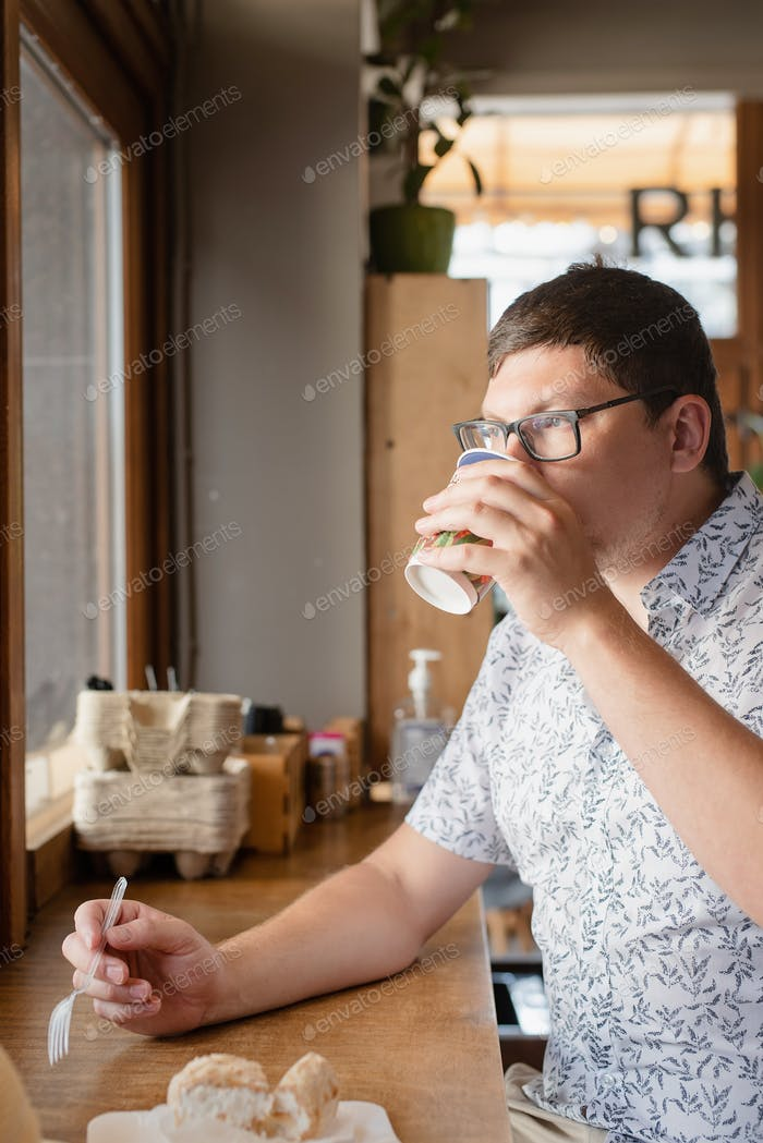 man drinking coffee in the cafe