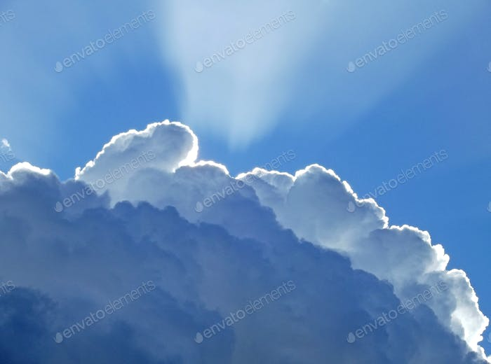 Rays of sunlight behind a cloud