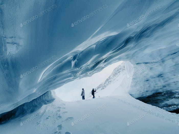 People standing in the ice cave