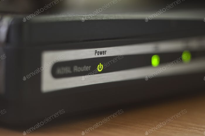 """Macro of internet modem, abstract technology background. Green """"power"""" indicator on internet router"""