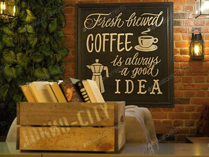 Fresh brewed coffee is always a good idea - decorative inscription on the wall of the cafe