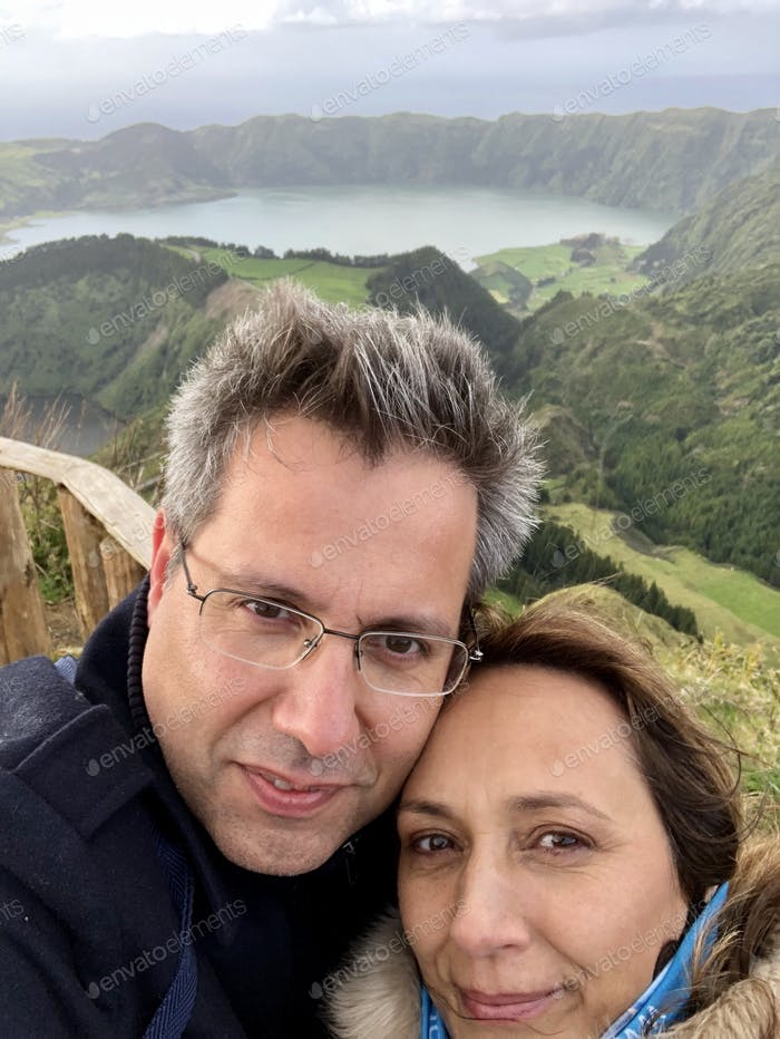 Couple in love taking a selfie with freezing cold at the famous viewpoint (Miradouro da Boca do